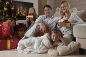 Happy Family At Home With Christmas Gifts