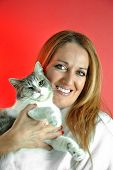 Portrait Of Pretty Woman Hugging Her Cat