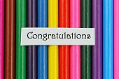 Congratulations card on background made of colorful pencils