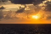 Orange Sunset Over Grey Seas