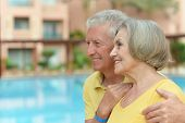 couple standing by pool