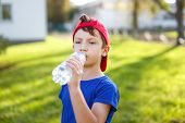 Little Boy Drink Water From Bottle