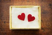 Two hearts inside a golden gift box. Gift of love. hearty gift.