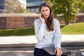 Irritated Woman Frowning As She Chats On A Mobile