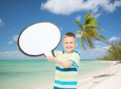 childhood, conversation, travel, summer and people concept - smiling little boy with blank text bubble over tropical beach background