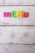 Inscription menu on wooden board close-up