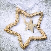 Christmas Star On The Snow And Grey Background