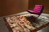Interior modern house, room with leather armchair and carpet