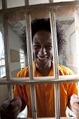 Happy Man In Prison Cell
