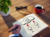 Businessman Drawing Sharing Concept on a Note Pad