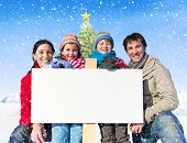 Christmas family with placard on winter.