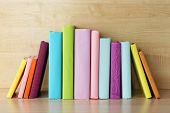 Books on wooden shelf close-up