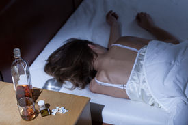stock photo of overdose  - Woman commited suicide from pills overdose - JPG
