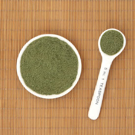 pic of moringa oleifera  - Moringa oleifera herb powder ayurvedic alternative medicine and superfood in a white porcelain bowl and measuring spoon over bamboo background - JPG