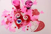 Valentines Day Decorations And Cupcakes With Heart Shaped Frosting