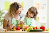 mom and kid preparing healthy food