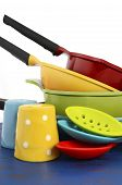 Bright Colorful Modern Kitchen Pot And Pans In Red, Yellow, Blue And Green Theme With Spoons And Sal