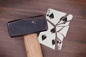 Hammer With A Broken Card, Five Of Spades