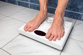 Female bare feet on bathroom scales