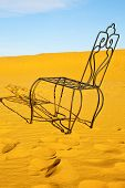 picture of sahara desert  - table and seat in desert sahara morocco africa yellow sand - JPG