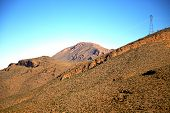 stock photo of atlas  - valley in africa morocco the atlas dry mountain ground isolated hill - JPG