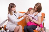 Doctor Listening Stethoscope Back At Girl Sitting In Hands Of Mother