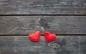 Red Hearts On Rustic Wood