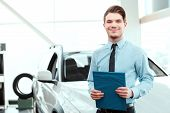 Handsome young man in dealership poster