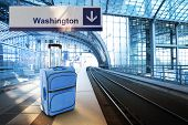 Departure For Washington. Blue Suitcase At The Railway Station