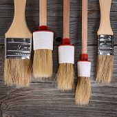 Paint Brush On A Wooden Background