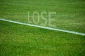 Football Lose text on grass with white lane