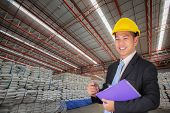 image of sugar industry  - Engineer working in the warehouse sugar bags - JPG