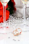 Two Golden Wedding Rings, Champagne Glasses