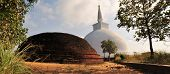 stock photo of hilltop  - Ancient white Mahaseya dagoba next to ruined stupa on hilltop at Mihintale Monastery, Sri Lanka ** Note: Visible grain at 100%, best at smaller sizes - JPG