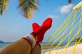 Woman Feet With Christmas Sock In Hammock On The Beach