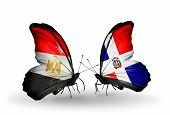 Two Butterflies With Flags On Wings As Symbol Of Relations Egypt And Dominicana