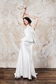 Beautiful bride with stylish wedding dress, perfect makeup and hair style in elegant interior
