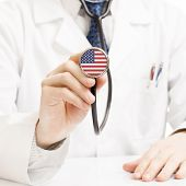 Doctor Holding Stethoscope With Flag Series - United States