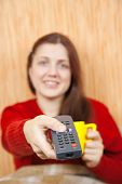 Girl Changing Channels With Clicker At Home