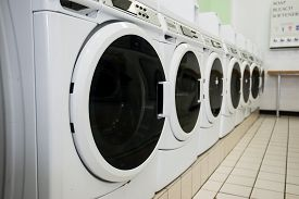 stock photo of time machine  - line of laundry machine in shop during business time - JPG