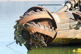 image of dredge  - rotor with blade of a big dredge in a channel - JPG