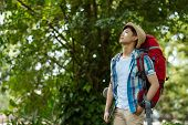 stock photo of breath taking  - Vietnamese young traveller taking break after a long way - JPG