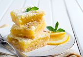 stock photo of icing  - Tangy lemon squares with icing sugar on plate - JPG