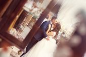 foto of forehead  - Capture of Groom kissing the bride on forehead - JPG