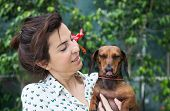 picture of dachshund dog  - A Attractive woman playing with dachshund dog - JPG