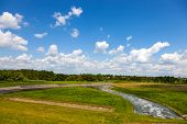 stock photo of dam  - Water flowing from the dam to the river Wieprz in Nielisz Poland - JPG
