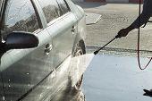 pic of pressure-wash  - The process of washing the car at the car wash - JPG