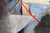 picture of pressure-wash  - The process of washing the car at the car wash - JPG