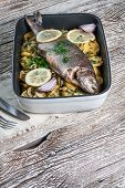 stock photo of baked potato  - Baked trout with potatoes and onions sprinkled with parsley - JPG