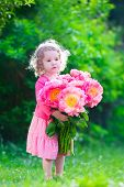 picture of little young child children girl toddler  - Little cute girl with peony flowers - JPG